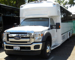 (H) Ford F550 Limousine Coach  (up to 28/34 Passengers)